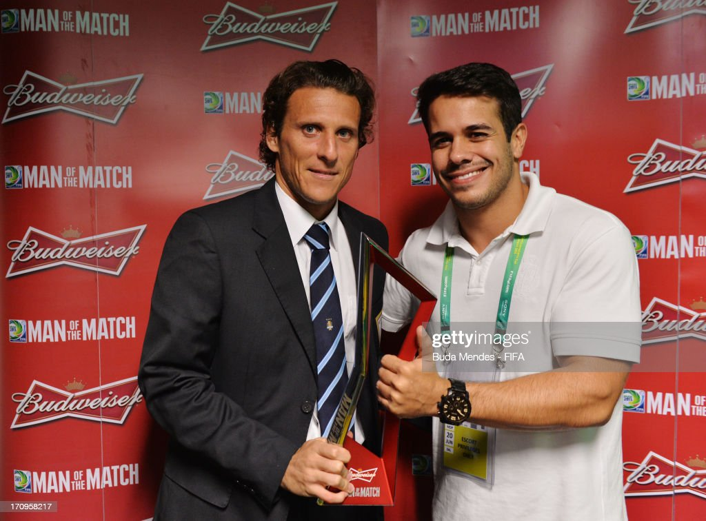 Diego Forlan of Uruguay is presented with the man of the match award after the FIFA Confederations Cup Brazil 2013 Group B match between Nigeria and Uruguay at Estadio Octavio Mangabeira (Arena Fonte Nova Salvador) on June 20, 2013 in Salvador, Brazil.