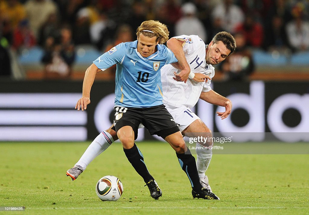 <a gi-track='captionPersonalityLinkClicked' href=/galleries/search?phrase=Diego+Forlan&family=editorial&specificpeople=171096 ng-click='$event.stopPropagation()'>Diego Forlan</a> of Uruguay is tackled by <a gi-track='captionPersonalityLinkClicked' href=/galleries/search?phrase=Jeremy+Toulalan&family=editorial&specificpeople=4321622 ng-click='$event.stopPropagation()'>Jeremy Toulalan</a> of France during the 2010 FIFA World Cup South Africa Group A match between Uruguay and France at Green Point Stadium on June 11, 2010 in Cape Town, South Africa.