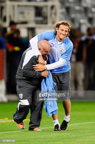 Diego Forlan of Uruguay jokes about with a member of coaching staff during a Uruguay training session ahead of the 2010 FIFA World Cup South Africa...