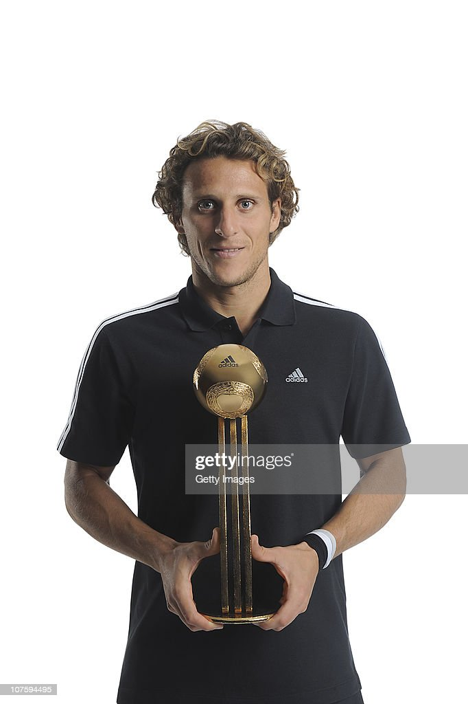 Diego Forlan of Uruguay poses with the adidas Golden Ball Winner Trophy at the adidas HQ on December 14, 2010 in Herzogenaurach, Germany.