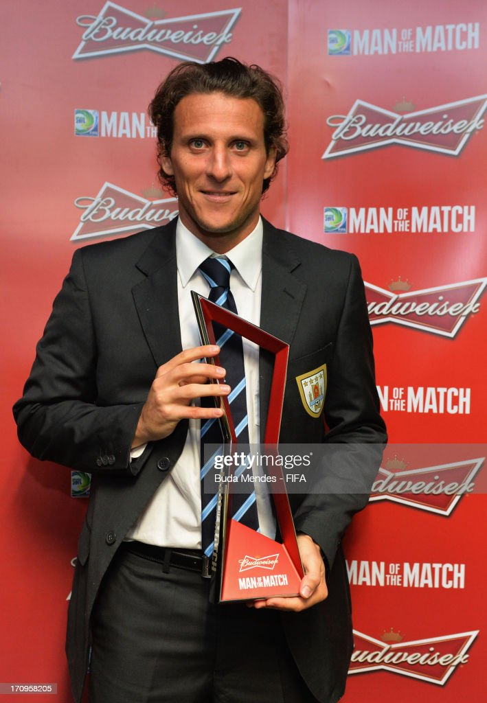 Diego Forlan of Uruguay poses with the man of the match award after the FIFA Confederations Cup Brazil 2013 Group B match between Nigeria and Uruguay at Estadio Octavio Mangabeira (Arena Fonte Nova Salvador) on June 20, 2013 in Salvador, Brazil.