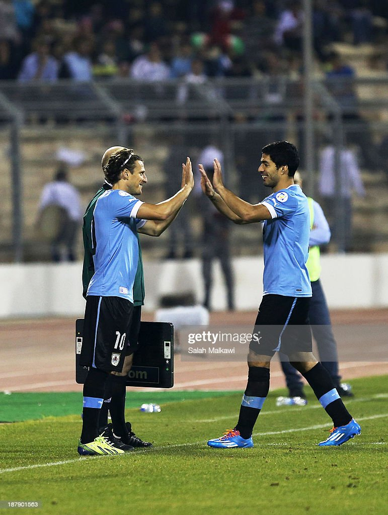 <a gi-track='captionPersonalityLinkClicked' href=/galleries/search?phrase=Diego+Forlan&family=editorial&specificpeople=171096 ng-click='$event.stopPropagation()'>Diego Forlan</a> of Uruguay replaces Luis Suarez during the FIFA 2014 World Cup Qualifier: Intercontinental Play-off First Leg between Jordan and Uruguay on November 13, 2013 in Amman, Jordan.