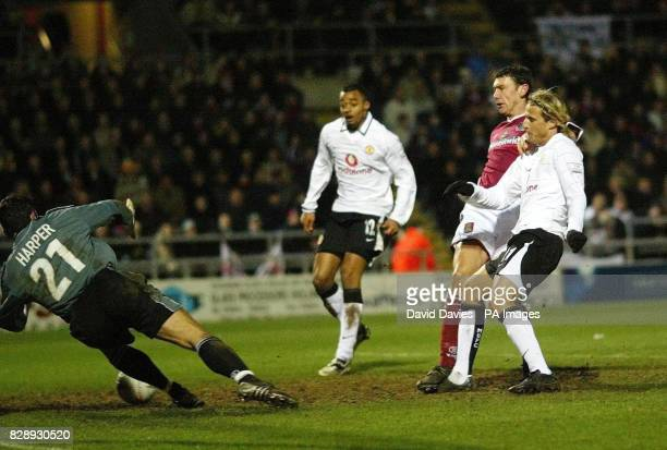 Diego Forlan scores Manchester United's third goal againt Northampton during their FA Cup Fourth Round match at Sixfields Stadium Northampton THIS...