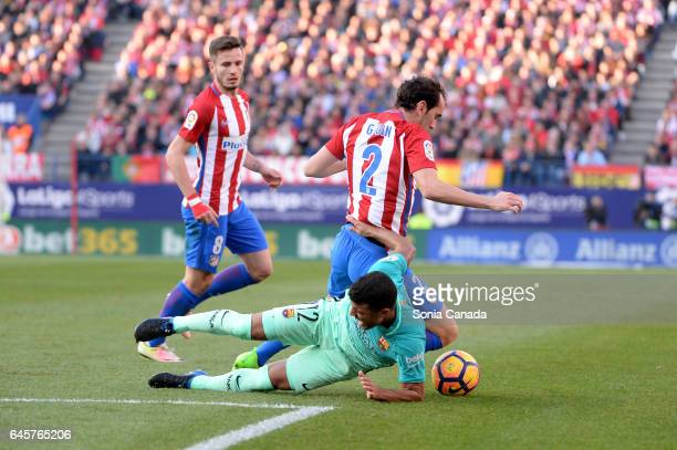 Diego Godin #2 of Atletico de Madrid and Rafinha #12 of FC Barcelona during The La Liga match between Club Atletico de Madrid v FC Barcelona La Liga...