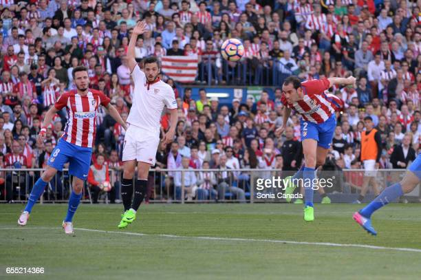 Diego Godin #2 of Atletico de Madrid scores to make it 10 during The La Liga match between Atletico Madrid v Valencia FC at Vicente Calderon on March...