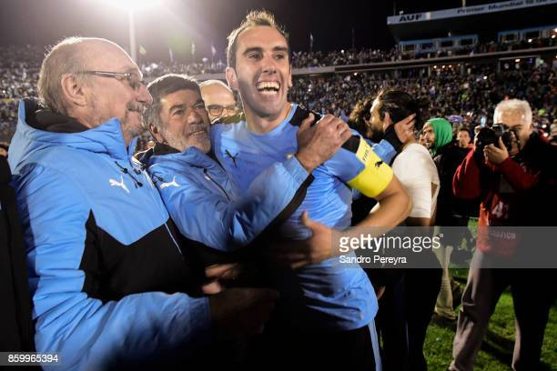 Diego Godin captain of Uruguay doctor Alberto Pan and physical trainer Jose Herrera celebrate the victory and qualifying to the World Cup after a...