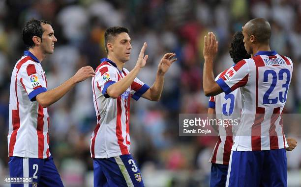 Diego Godin Guilherme Siqueira and Joao Miranda of Atletico de Madrid celebrate after beating Real Madrid 21 in the La Liga match between Real Madrid...