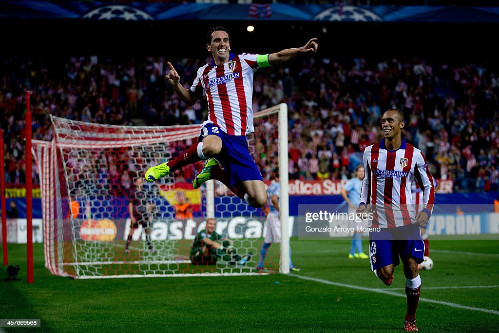 <a gi-track='captionPersonalityLinkClicked' href=/galleries/search?phrase=Diego+Godin&family=editorial&specificpeople=608999 ng-click='$event.stopPropagation()'>Diego Godin</a> (L) jumps to celebrate scoring their fourth goal close to his team mate Joao Miranda (R) during the UEFA Champions League group A match between Club Atletico de Madrid and Malmo FF at Vicente Calderon stadium on October 22, 2014 in Madrid, Spain.