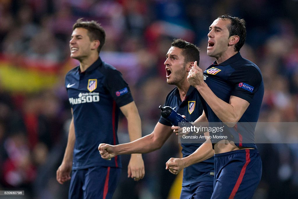 <a gi-track='captionPersonalityLinkClicked' href=/galleries/search?phrase=Diego+Godin&family=editorial&specificpeople=608999 ng-click='$event.stopPropagation()'>Diego Godin</a> (R), <a gi-track='captionPersonalityLinkClicked' href=/galleries/search?phrase=Koke+-+Soccer+Midfielder+-+Born+1992&family=editorial&specificpeople=11132098 ng-click='$event.stopPropagation()'>Koke</a> (2ndR) and Lucas Hernandez Pi (L) of Atletico de Madrid celebrate their victory with teammates after winning the UEFA Champions League quarter final, second leg match between Club Atletico de Madrid and FC Barcelona at the Vincente Calderon on April 13, 2016 in Madrid, Spain.
