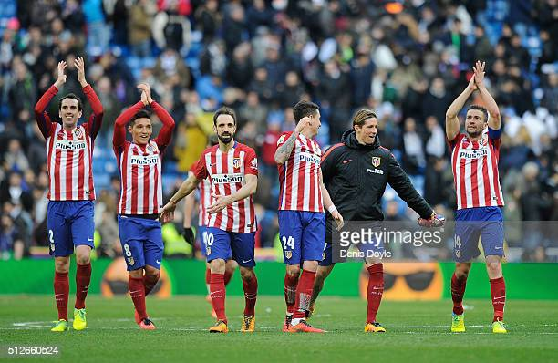 Diego Godin Matias Kranevitter Juanfran Jose Maria Gimenez Fernando Torres and Gabi Fernandez of Club Atletico de Madrid celebrate after they beat...