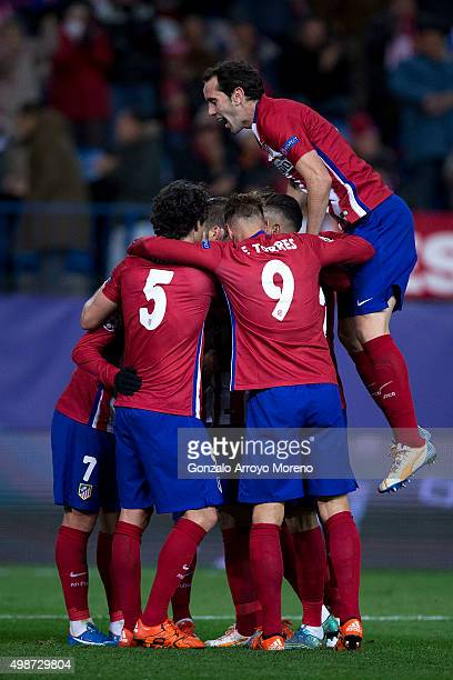 Diego Godin of Atletico de Madrid celebrates Antoine Griezmann second goal jumping over his teammates during the UEFA Champions League Group C match...