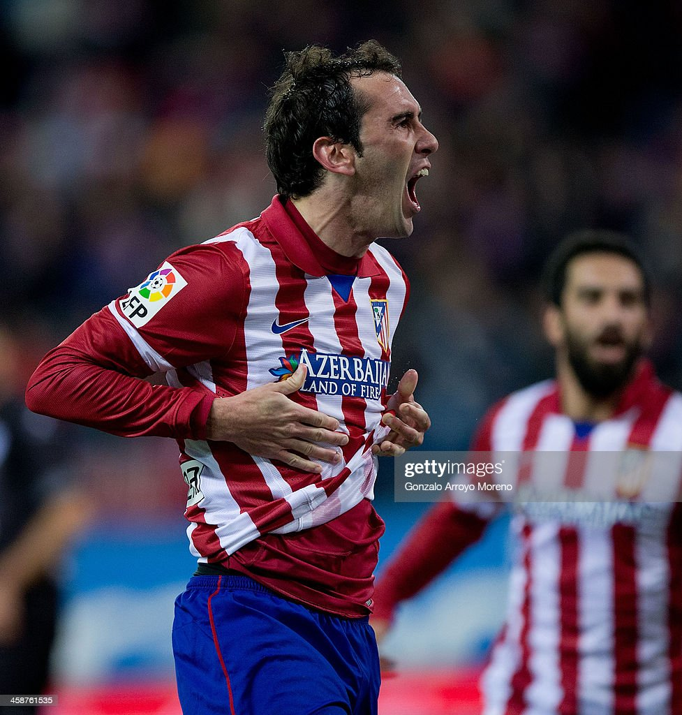 Diego Godin of Atletico de Madrid celebrates scoring their opening goal during the La Liga match between Club Atletico de Madrid and Levante UD at Vicente Calderon Stadium on December 21, 2013 in Madrid, Spain.