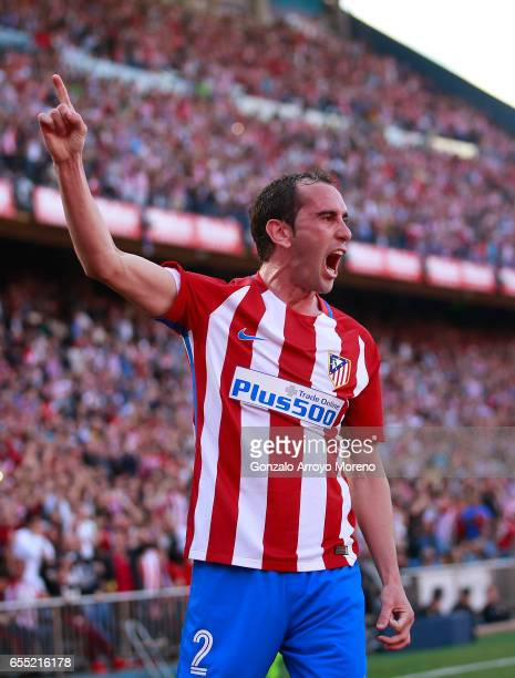 Diego Godin of Atletico de Madrid celebrates scoring their opening goal during the La Liga match between Club Atletico de Madrid and Sevilla FC at...