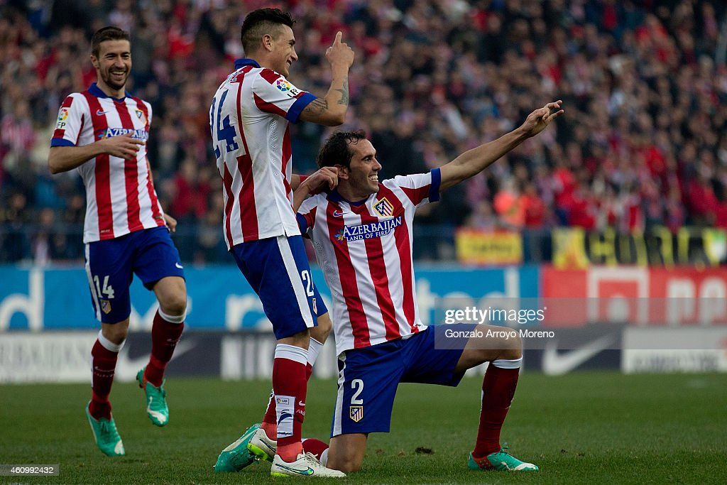 <a gi-track='captionPersonalityLinkClicked' href=/galleries/search?phrase=Diego+Godin&family=editorial&specificpeople=608999 ng-click='$event.stopPropagation()'>Diego Godin</a> (R) of Atletico de Madrid celebrates scoring their third goal with team-mates Jose Maria Gimenez (2ndR) and <a gi-track='captionPersonalityLinkClicked' href=/galleries/search?phrase=Gabi+-+Soccer+Player&family=editorial&specificpeople=6912055 ng-click='$event.stopPropagation()'>Gabi</a> Fernandez (L) during the La Liga match between Club Atletico de Madrid and Levante UD at Vicente Calderon Stadium on January 3, 2015 in Madrid, Spain.