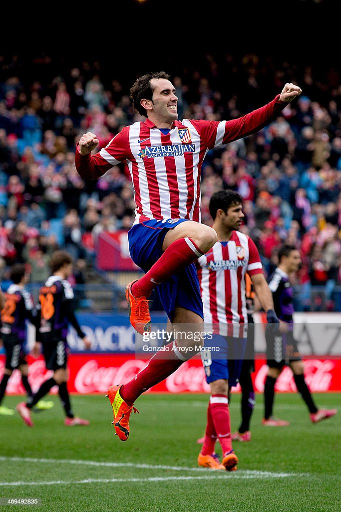 Diego Godin of Atletico de Madrid jumps, celebrating scoring their third goal during the La Liga match between Club Atletico de Madrid and Real Valladolid CF at Vicente Calderon Stadium on February 15, 2014 in Madrid, Spain.
