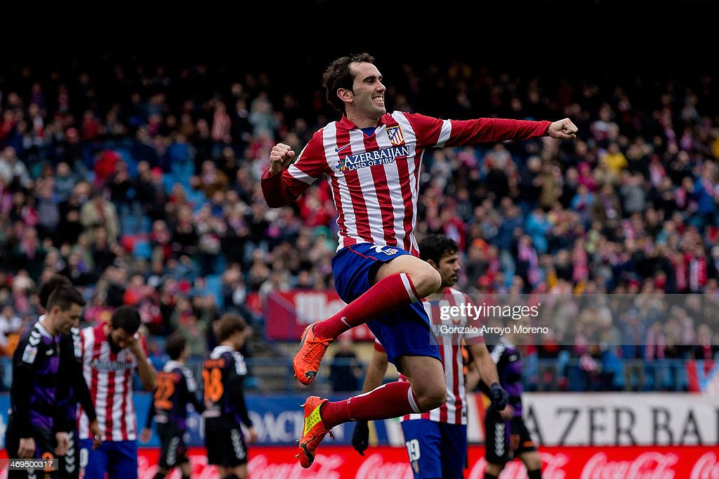 Diego Godin of Atletico de Madrid jumps to celebrate scoring their third goal during the La Liga match between Club Atletico de Madrid and Real Valladolid CF at Vicente Calderon Stadium on February 15, 2014 in Madrid, Spain.
