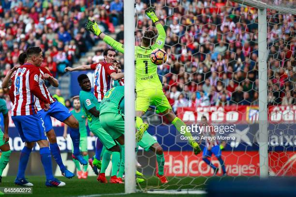 Diego Godin of Atletico de Madrid scores their opening goal during the La Liga match between Club Atletico de Madrid and FC Barcelona at Vicente...