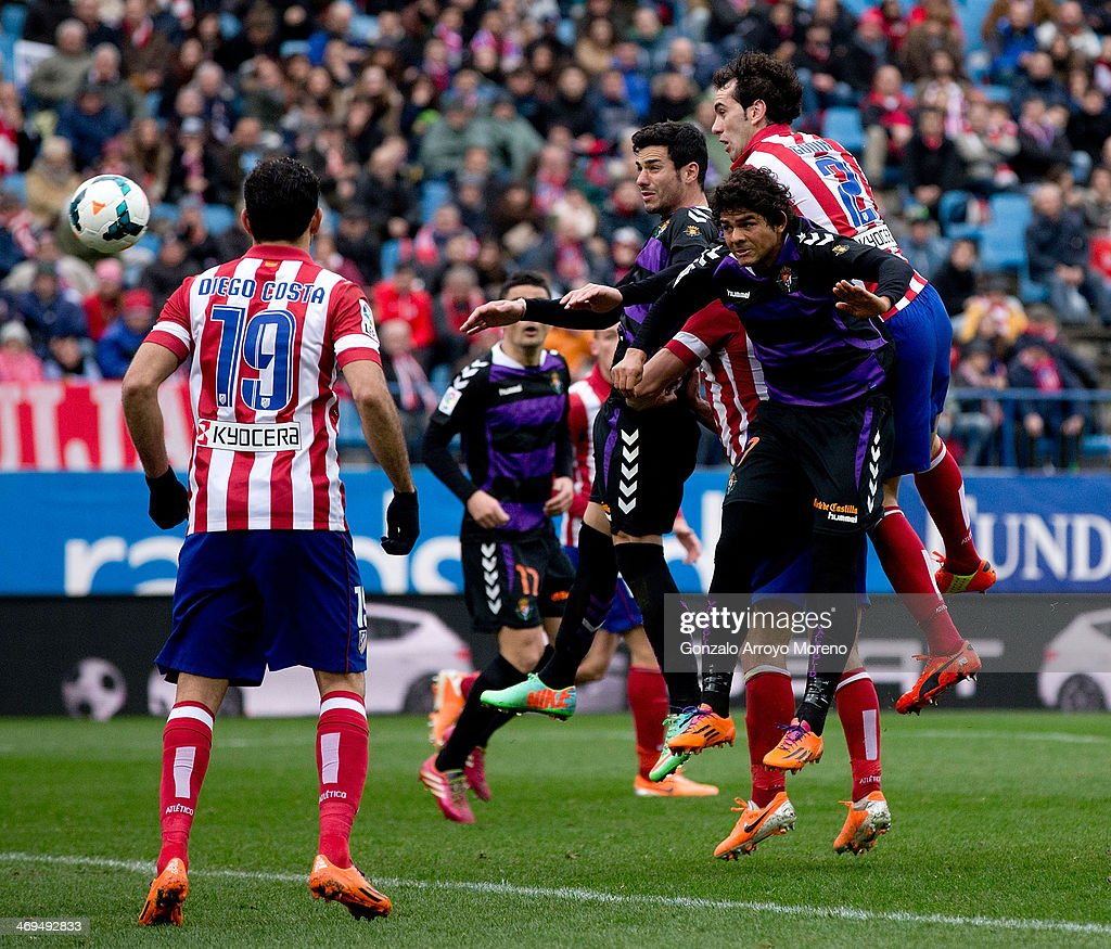 Diego Godin of Atletico de Madrid scores their third goal from a header during the La Liga match between Club Atletico de Madrid and Real Valladolid CF at Vicente Calderon Stadium on February 15, 2014 in Madrid, Spain.