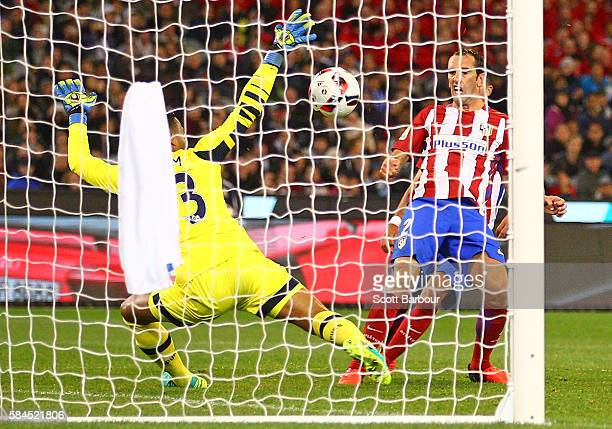Diego Godin of Atletico de Madrid shoots and scores their first goal during 2016 International Champions Cup Australia match between Tottenham...