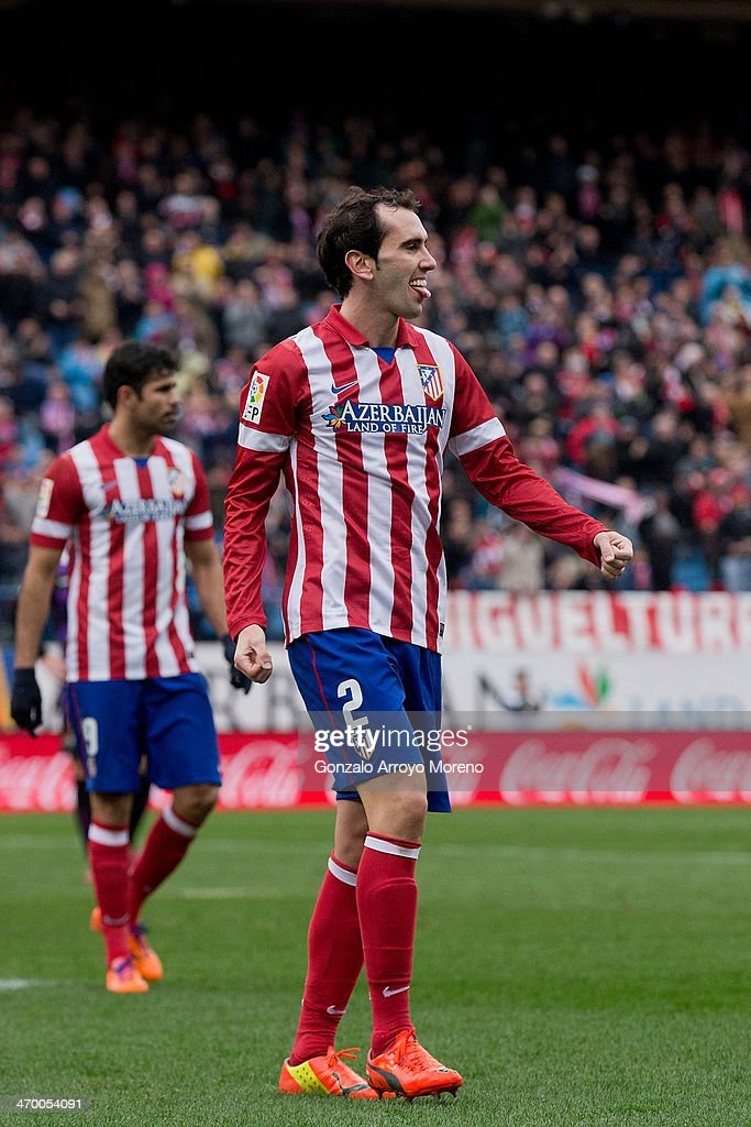 Diego Godin of Atletico de Madrid shows his tounge celebrating scoring their third goal during the La Liga match between Club Atletico de Madrid and Real Valladolid CF at Vicente Calderon Stadium on February 15, 2014 in Madrid, Spain.