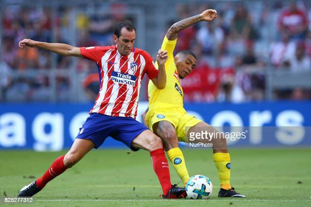 Diego Godin of Atletico de Madrid tackling on Allan Loudeiro of Napoli durign the first Audi Cup football match between Atletico Madrid and SSC...