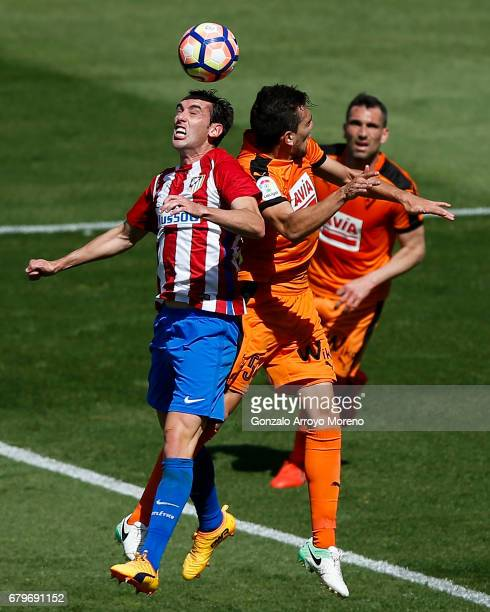 Diego Godin of Atletico de Madrid wins the header after Gonzalo Escalante of SD Eibar during the La Liga match between Club Atletico de Madrid and SD...