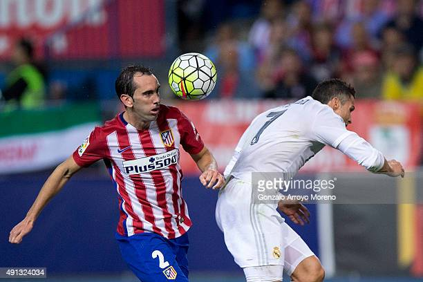 Diego Godin of Atletico de Madrid wins the header before Cristiano Ronaldo of Real Madrid CF during the La Liga match between Club Atletico de Madrid...