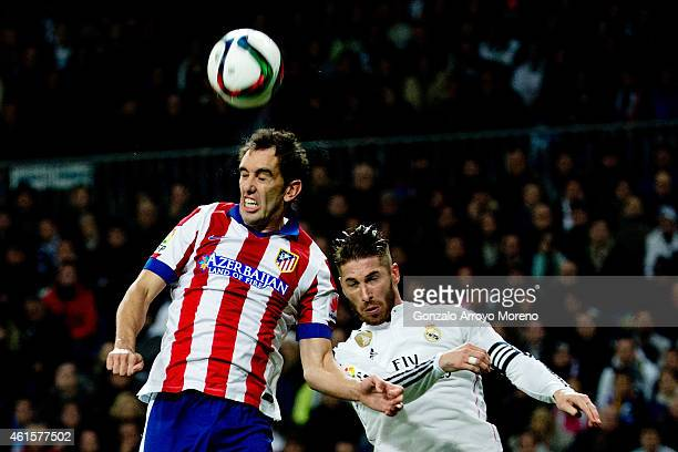 Diego Godin of Atletico de Madrid wins the header from Sergio Ramos of Real Madrid CF during the Copa del Rey Round of 16 second leg match between...