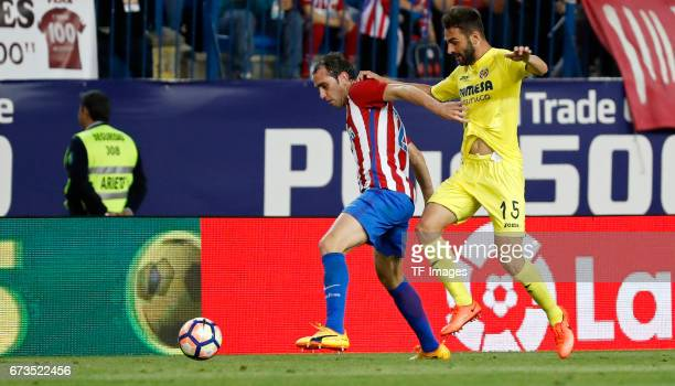 Diego Godin of Atletico Madrid and Adrian of Villarreal battle for the ball during the La Liga match between Club Atletico de Madrid and Villarreal...