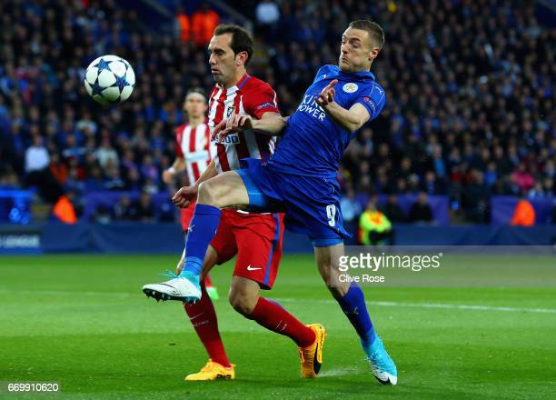 Diego Godin of Atletico Madrid and Jamie Vardy of Leicester City battle for possession during the UEFA Champions League Quarter Final second leg...