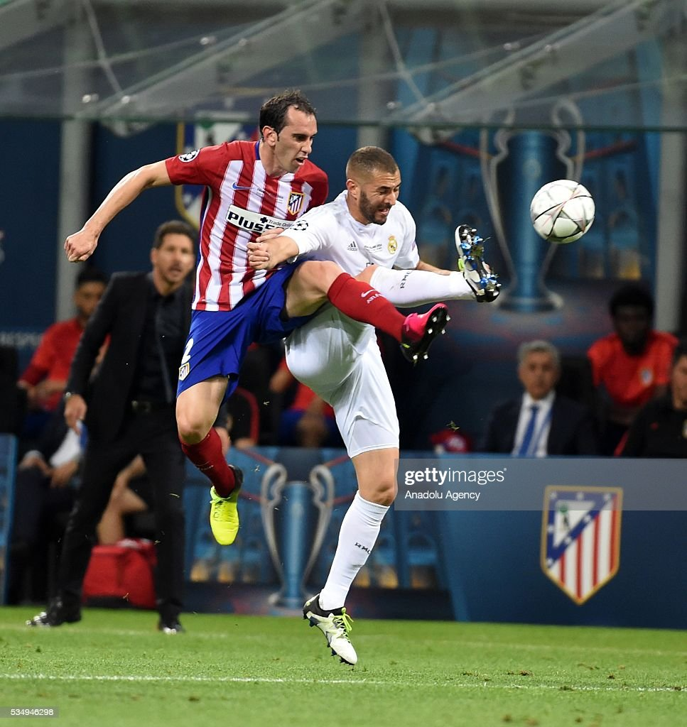 Diego Godin (L) of Atletico Madrid and Karim Benzema (R) of Real Madrid vie for the ball during the UEFA Champions League Final between Real Madrid CF and Atletico Madrid at the Giuseppe Meazza Stadium in Milan, Italy on May 28, 2016 in Milan, Italy.