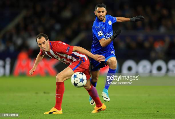 Diego Godin of Atletico Madrid and Riyad Mahrez of Leicester City battle for possession during the UEFA Champions League Quarter Final second leg...