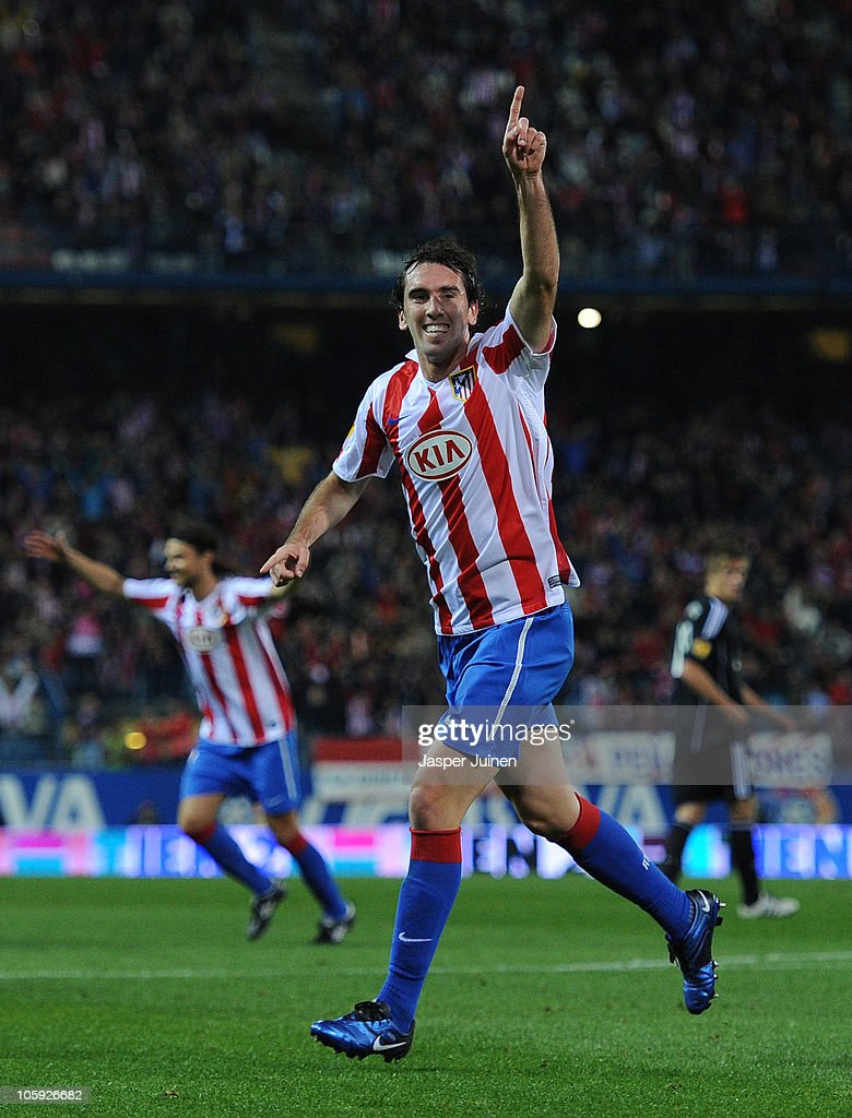<a gi-track='captionPersonalityLinkClicked' href=/galleries/search?phrase=Diego+Godin&family=editorial&specificpeople=608999 ng-click='$event.stopPropagation()'>Diego Godin</a> of Atletico Madrid celebrates scoring his sides opening goal during the UEFA Europa League group B match between Atletico Madrid and Rosenborg at the Vicente Calderon Stadium on October 21, 2010 in Madrid, Spain.