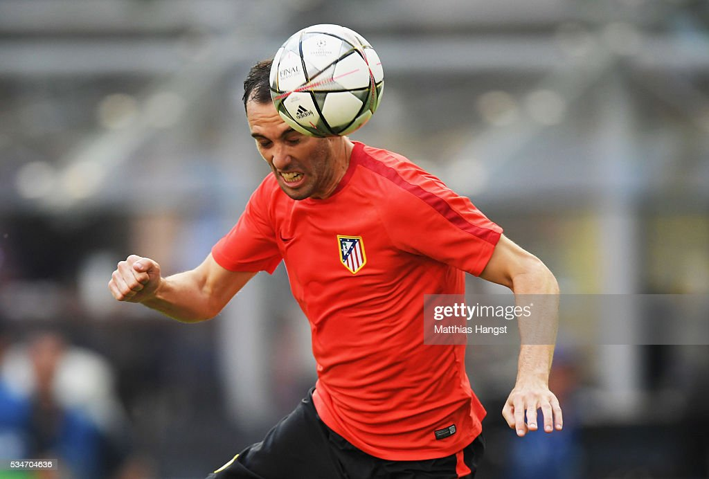 <a gi-track='captionPersonalityLinkClicked' href=/galleries/search?phrase=Diego+Godin&family=editorial&specificpeople=608999 ng-click='$event.stopPropagation()'>Diego Godin</a> of Atletico Madrid jumps to head the ball during an Atletico de Madrid training session on the eve of the UEFA Champions League Final against Real Madrid at Stadio Giuseppe Meazza on May 27, 2016 in Milan, Italy.