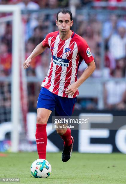 Diego Godin of Atletico Madrid runs with the ball during the Audi Cup 2017 match between Club Atletico de Madrid and SSC Napoli at Allianz Arena on...