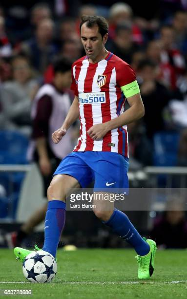 Diego Godin of Atletico runs with the ball during the UEFA Champions League Round of 16 second leg match between Club Atletico de Madrid and Bayer...
