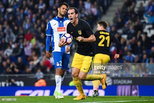 Diego Godin of Club Atletico de Madrid celebrates after his team mate Antoine Griezmann of Club Atletico de Madrid scored the opening goal during the...