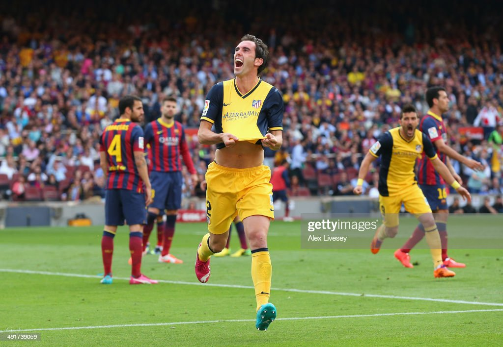 <a gi-track='captionPersonalityLinkClicked' href=/galleries/search?phrase=Diego+Godin&family=editorial&specificpeople=608999 ng-click='$event.stopPropagation()'>Diego Godin</a> of Club Atletico de Madrid celebrates after scoring his goal during the La Liga match between FC Barcelona and Club Atletico de Madrid at Camp Nou on May 17, 2014 in Barcelona, Spain.