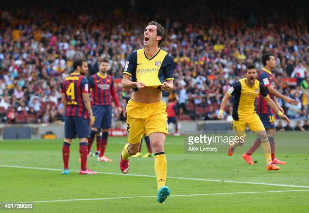 Diego Godin of Club Atletico de Madrid celebrates after scoring his goal during the La Liga match between FC Barcelona and Club Atletico de Madrid at...