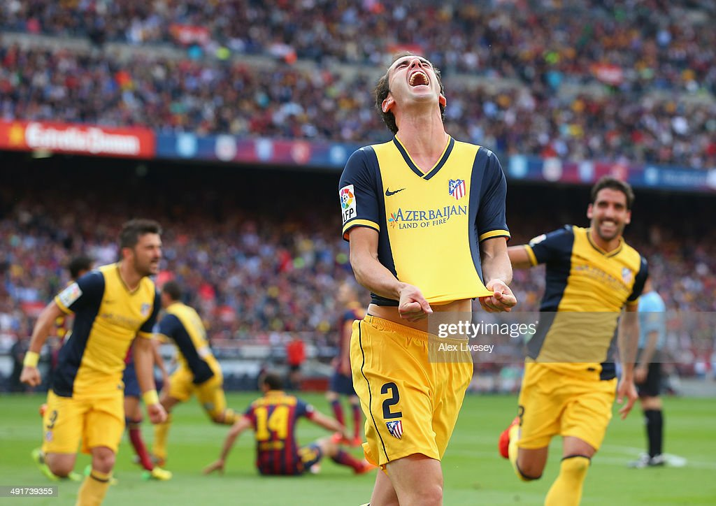Diego Godin of Club Atletico de Madrid celebrates after scoring his goal during the La Liga match between FC Barcelona and Club Atletico de Madrid at Camp Nou on May 17, 2014 in Barcelona, Spain.