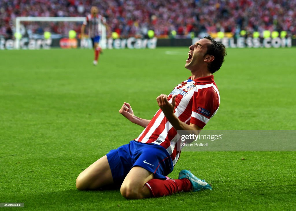 <a gi-track='captionPersonalityLinkClicked' href=/galleries/search?phrase=Diego+Godin&family=editorial&specificpeople=608999 ng-click='$event.stopPropagation()'>Diego Godin</a> of Club Atletico de Madrid celebrates scoring the opening goal during the UEFA Champions League Final between Real Madrid and Atletico de Madrid at Estadio da Luz on May 24, 2014 in Lisbon, Portugal.