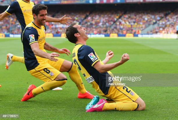 Diego Godin of Club Atletico de Madrid celebrates with Raul Garcia after scoring his goal during the La Liga match between FC Barcelona and Club...