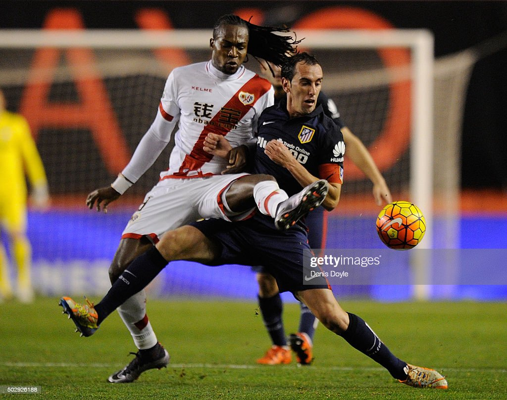 <a gi-track='captionPersonalityLinkClicked' href=/galleries/search?phrase=Diego+Godin&family=editorial&specificpeople=608999 ng-click='$event.stopPropagation()'>Diego Godin</a> of Club Atletico de Madrid is tackled by Mateus Alberto Contreiras ''Manucho'' of Rayo Vallecano during the La Liga match between Club Atletico de Madrid and Rayo Vallecano de Madrid at Estadio de Vallecas on December 30, 2015 in Madrid, Spain.