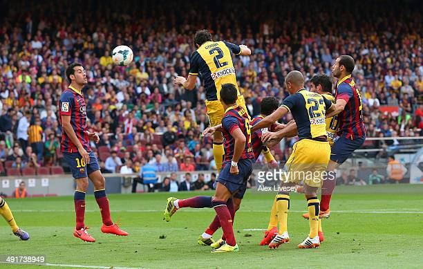 Diego Godin of Club Atletico de Madrid scores his goal during the La Liga match between FC Barcelona and Club Atletico de Madrid at Camp Nou on May...
