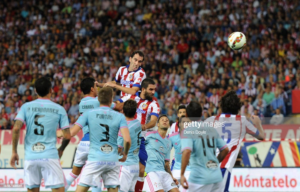 <a gi-track='captionPersonalityLinkClicked' href=/galleries/search?phrase=Diego+Godin&family=editorial&specificpeople=608999 ng-click='$event.stopPropagation()'>Diego Godin</a> of Club Atletico de Madrid scores his team's 2nd goal during the La Liga match at the Vicente Calderon stadium on September 20, 2014 in Madrid, Spain.
