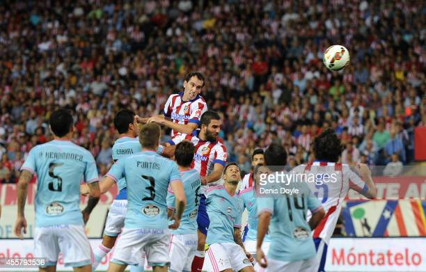 Diego Godin of Club Atletico de Madrid scores his team's 2nd goal during the La Liga match at the Vicente Calderon stadium on September 20 2014 in...