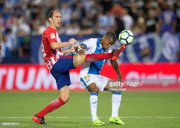 Diego Godin of Club Atletico de Madrid tackles Claudio Beauvue of CD Leganes during the La Liga match between Leganes and Atletico Madrid at Estadio...