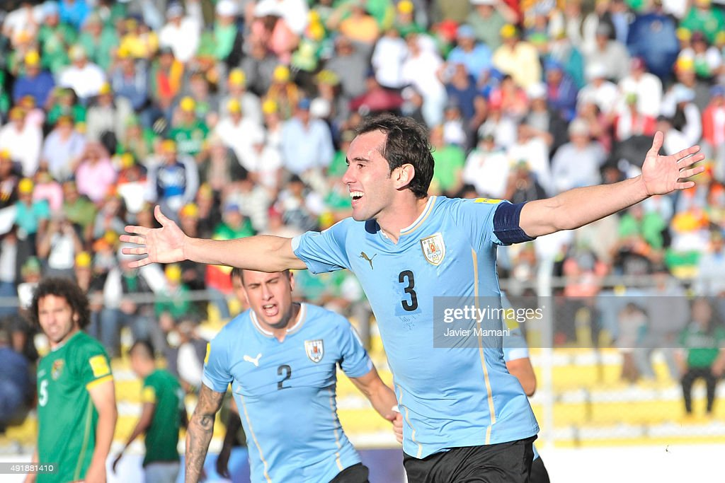 <a gi-track='captionPersonalityLinkClicked' href=/galleries/search?phrase=Diego+Godin&family=editorial&specificpeople=608999 ng-click='$event.stopPropagation()'>Diego Godin</a> of Uruguay celebrates after scoring the second goal of his team during a match between Bolivia and Uruguay as part of FIFA 2018 World Cup Qualifier at Hernando Siles Stadium on October 08, 2015 in La Paz, Bolivia.