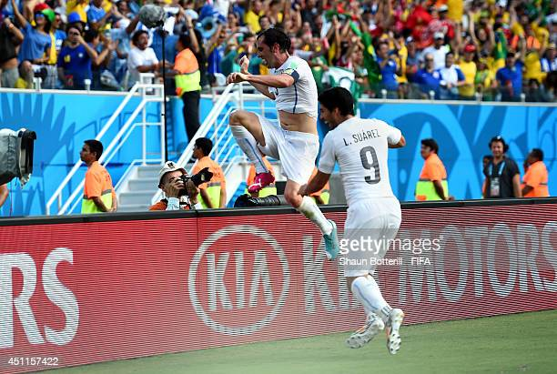Diego Godin of Uruguay celebrates scoring his team's firs goal during the 2014 FIFA World Cup Brazil Group D match between Italy and Uruguay at...