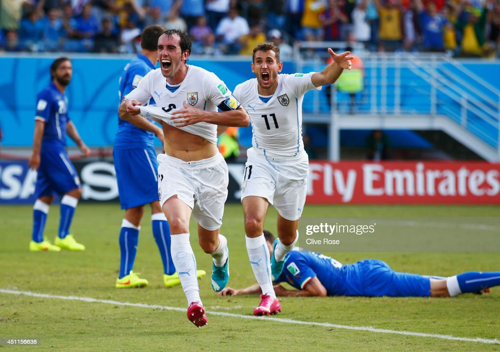 <a gi-track='captionPersonalityLinkClicked' href=/galleries/search?phrase=Diego+Godin&family=editorial&specificpeople=608999 ng-click='$event.stopPropagation()'>Diego Godin</a> of Uruguay celebrates scoring his team's first goal during the 2014 FIFA World Cup Brazil Group D match between Italy and Uruguay at Estadio das Dunas on June 24, 2014 in Natal, Brazil.